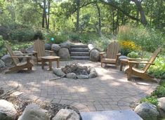 Stone patio & firepit! Would love something like this, someday, in my outdoor kitchen. :-)