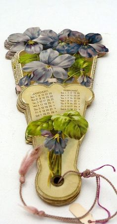 Victorian Paper Fan Featuring Violets...is no longer on website. Inspiration only to make something along the same line just not a calendar....paper?? Maybe quilled even!