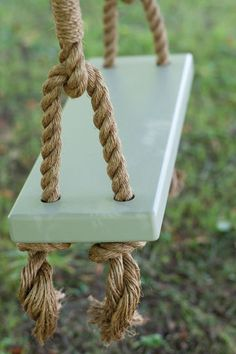 outdoor swing, painted in french gray from farrow ball. what a pretty swing. Diy Swing, Rope Swing, Farrow Ball, Wooden Swings, Wooden Tree Swing, Front Door Colors, Stone Houses, Outdoor Projects, Play Houses