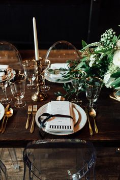 Wedding reception place setting, gold flatware, black and white striped menus, lucite chairs, gold-rimmed plates and glasses // Corrine Kensington Photography