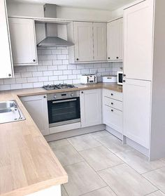 32 ideas for the small kitchen. Modern kitchen with a narrow design and wooden worktop. Page 30 of 32 – White N Black Kitchen Cabinets Home Decor Kitchen, Kitchen Interior, New Kitchen, Kitchen Wood, Floors Kitchen, Kitchen Grey, Awesome Kitchen, White Kitchen Floor Tiles, Happy Kitchen