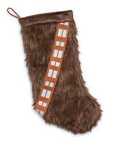 What do Wookies expect to get in their stockings? A travel Dejarik game? A mini crossbow? Fur mousse? Walking carpet cleaner? You'll have to hang up this ThinkGeek-exclusive Chewbacca stocking on your mantel to find out!