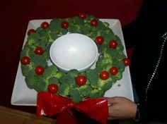 Tomato and brocolli wreath. My sister made this for our family's Christmas gathering. She made her bow out of a red pepper and she thinks she's not creative! Very festive! It tasted as good as it looked! B