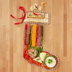Show off your fabulous new Hickory Farms products this holiday season by arranging them into this festive stocking. Your family and friends will definitely be impressed, and satisfied.