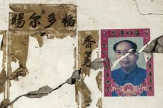 """CHINA-QUAKE/ A portrait of late Chinese Chairman Mao Zedong is torn by cracks on a wall after Saturday's earthquake, in Longxing village, Lushan county, Sichuan province April 23, 2013. Hundreds of survivors of an earthquake that killed nearly 200 people in southwest China pushed into traffic on a main road on Monday, waving protest signs, demanding help and shouting at police. The Chinese characters (L) on the wall read """"Bless you"""". REUTERS/Stringer"""