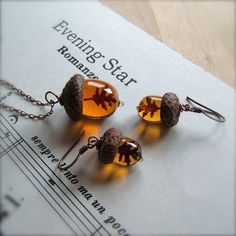 Beautiful glass acorn necklace with matching earrings from etsy seller bullseyebeads.