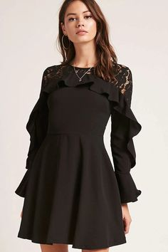 A woven mini dress featuring a guipure lace yoke and long sleeves, a ruffled trim along the chest and bell sleeve cuffs, a round neckline, and a concealed back zipper.<p>- This is an independent brand and not a Forever 21 branded item.</p>