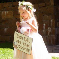 A flower girl precedes the bride down the aisle