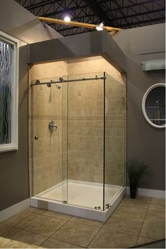 You can also opt for walk in shower designs without doors. Take a look at our bathroom remodeling ideas, compiled from our previous projects. Walk In Shower Designs, Bathroom Tile Designs, Modern Bathroom Design, Modern Bathrooms, Framed Shower Door, Frameless Sliding Shower Doors, Open Showers, Waterfall Shower, Diy Shower