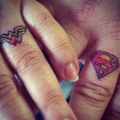 Superman and Wonder Woman ring tattoos