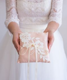 This sweet and dainty blush ring bearer pillow by IselleBridalStudio via etsy  is perfect for the elegant bride. #ringpillow