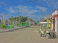 By foot, on moped or slow cruising golf cart...these are the only means of transportation around the small island.