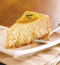 Recipe for Tropical Breeze Mango Coconut Cheesecake - Taste of the tropics cheesecake, this recipes is mouthwatering to look at, easy to prepare and perfect for sharing!
