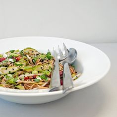 1/4 cup neutral oil, such as grapeseed or canola 3 tablespoons toasted sesame oil 1 tablespoon chili oil 1/2 cup soy sauce 3 tablespoons balsamic vinegar 3 1/2 tablespoons dark brown sugar 2 teaspoons kosher salt 1 tablespoon minced ginger 1 garlic clove, minced 1 9-1/2-ounce package soba noodles 1 bunch asparagus, ribboned 2 red bell peppers, roasted and sliced, or 1 cup jarred roasted bell peppers, drained 2 large handfuls mung bean sprouts 1 bunch scallions, thinly sliced 1/4 cup toasted…