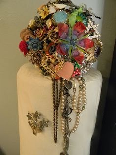 Trail your Brooch Bouquets adding vintage pearls and recycle old necklaces | Brooch Bouquets