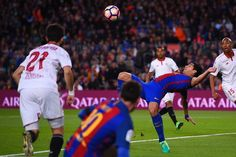 Barcelona's Uruguayan forward Luis Suarez (C) jumps to score during the Spanish league football match FC Barcelona vs Sevilla FC at the Camp Nou stadium in Barcelona on April 5, 2017. / AFP PHOTO / Josep LAGO