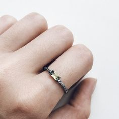 silver ring with green baguette gem