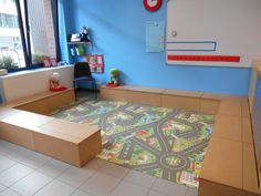 A whole area for car play! I have this rug in my classroom but don't have it sectioned off