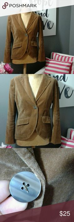 Banana Republic velvet blazer brown size 0 Chic Banana Republic brown velvet blazer, size 0, made of 100% cotton.  It has a single button closure in the front of the blazer and 5 smaller matching buttons on the sleeves. The front of the blazer curves and the waist is tapered in, creating a beautiful silhouette.  The back has an opening for ease of wear.  There are two pockets in the front. Excellent used condition. The inner lining is smooth with no tears. Banana Republic Jackets & Coats…