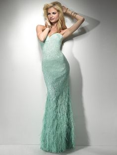 Aqua Gown....sequins, feathers and ombre color fused together to create subtle sophistication. Finished with a sweetheart neckline.