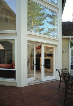 This patio door makes the deck. It's hard to imagine this deck without this patio door. In this case, with the dramatic picture windows above and surrounding, this garden door becomes a centerpiece of style and amps up the deck in a big way. Bedroom Wall Designs, Boho Bedroom Decor, Patio Windows, Windows And Doors, Hinged Patio Doors, House Deck, House 2, Magic Garden, Olive Garden
