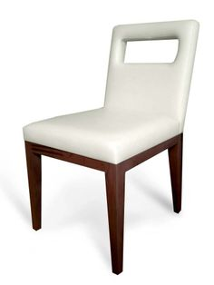 """Canal Chair  The Canal is an elegant contemporary upholstered dining chair with a sturdy wooden base and legs. The Canal chair can serve multiple purposes, such as a task, side or dining chair. This side chair's optional cut out in the back rest allows the user to easily pick up and move the chair. Measurements as Shown: 18""""w x 24""""d x 34""""h"""