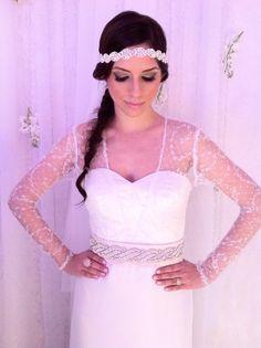 long-sleeved wedding dress by CAROLINA RODRIGUEZ with blush pink silk sash and bridal headband