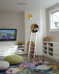 Kids playroom, large floral area rug, knit poufs, custom kids play house with white ladder - Kids Room Ideas Small Playroom, Playroom Design, Kids Room Design, Playroom Decor, Playroom Ideas, Playroom Organization, Organization Ideas, Colorful Playroom, Small Kids Playrooms