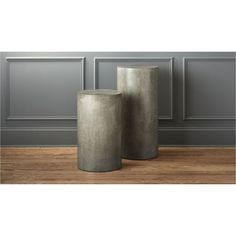Shop column grey pedestals.   Handcrafted of cement, stone and natural fibers, this industrial chic pedestal structure gives architectural rise to art or botanicals.  Also makes a solid side table. For bright ideas on sprucing up a work studio, head to .