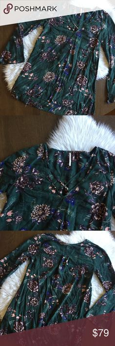 "Free People Emerald Green Floral Tunic Mini Dress Deep emerald green Floral Tunic length top or mini dress with cross detail at chest. Gently worn. 💫 Smoke free home. Offers are welcome though the ""offer"" button. No negotiations in the comments. No trades/holds/modeling requests, please. 1 day average ship time. Bundle multiple items for a discount and only pay for shipping once! Free People Dresses Mini"