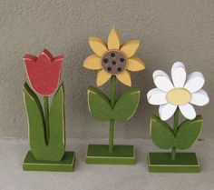 "3 Tall Standing Flower Block Set for Spring decor by lisabees The bases are are 2-1/2"" wide X 4-1/2"" long X 3/4"" thick. The sunflower stand is about 12"" tall base to top. The tulip stand is about 10"" tall base to top. The daisy is about 9"" tall base to top. $34.95"