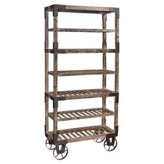 This fresh and delightful take on a kitchen baker's rack features weathered grey wood with aged metal wheels and accents, as well as 7 spacious shelves. Its unique, rustic aesthetic will make this Foundry Rack a treasured piece of furniture in your home. Glass Shelves, Display Shelves, Wall Shelves, Floating Shelves, Industrial Bakers Racks, Rustic Industrial, Industrial Furniture, Repurposed Furniture, Industrial Hardware