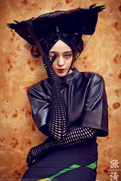 Chen Man captures Chinese star Fan Bingbing for the fall issue (2012) of i-D Magazine. Styled by Tim Lim, the actress wows in embellished pieces from the likes of Alexander McQueen, Alexander Wang and Gucci. Decorative headpieces and other accessories are complemented by hair stylist Gao Jian and makeup artist Bu Kewen's daring beauty looks.