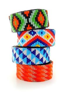 Hand beaded cuff bracelets from www.melangecollection.com  They're hand made by wonderful group of women in Guatemala.
