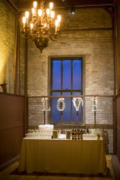 Offer a signature cocktail to your guests on their elevator ride to the event space at Bridgeport Art Center's Skyline Loft!  Photo by Shane Welch Photography