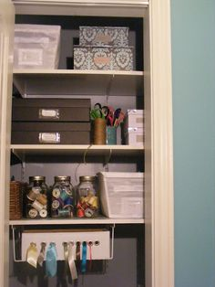 Craft Closet!  Even I have room for that.  I love the smart use of different containers that aren't intended for craft storage, like shakers for glitter and a file organizer for bags and tissue paper.