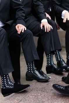 Black and white polka dot groomsmen socks! http://www.stylemepretty.com/illinois-weddings/chicago/2016/12/07/the-peninsula-chicago-wedding/ Photography: Emilia Jane - http://emiliajanephotography.com/
