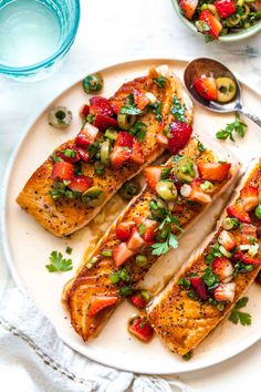 Salmon with Strawberry-Scallion Tapenade is perfect for entertaining or easy weeknight dinner. This healthy recipe comes together in just 20 minutes. #salmonrecipes #grilledsalmon #strawberrysalsa #salmonrecipeshealthy #salmonrecipeseasy #tapenade