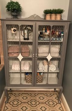Vintage China cabinet/Linen cabinet finished in General Finishes Driftwood and Seagull Gray. Glass has been replaced with chicken wire