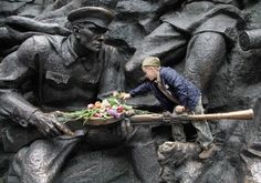 A boy dressed in a Soviet army uniform forage cap places flowers at the monument of the Unknown Soldier at a memorial to World War II veterans in a memorial park in Kiev, Ukraine on May 9. Ukrainians continue to celebrate the World War II anniversary and Victory Day on May 9 as a national holiday marking the defeat of Nazi German forces in the second World War