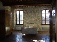 A STONE HOUSE WITH LOTS OF CHARACTER IN A MEDIAEVAL VILLAGE IN THE MINERVOIS, WITH TWO SUN TERRACES, A SMALL COURTYARD.  €183,600/£150,038