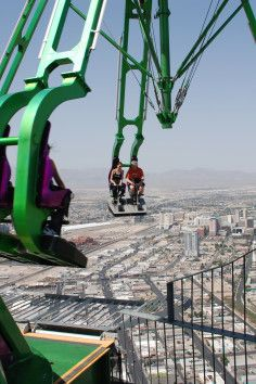 Stratosphere Thrill Rides - Insanity the Ride is a truly mind-bending experience! A massive mechanical arm extending out 64 feet over the edge of the Stratosphere Tower at a height of over 900 feet, this Vegas ride will spin you and several other passengers in the open air at speeds of up to three 'G's. You'll be propelled up to an angle of 70 degrees, which will tilt your body into one position — straight down!
