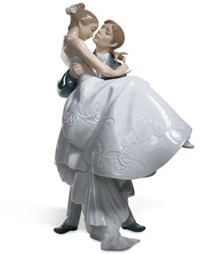 "The handsome groom carries his blushing bride over the threshhold in this romantic scene from Lladro. Porcelain. Measures 10.75"" x 6.75"". 