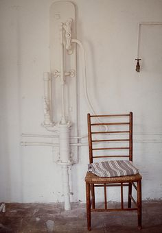 The well, tap and chair by Lawrence Garwood, via Flickr