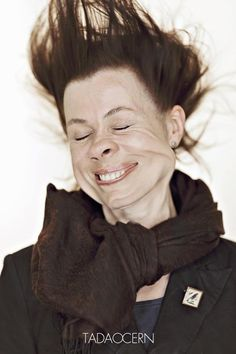 photographic portraits of people having gale force winds blown in their faces.