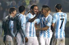 Napoli forward Higuain grins as he is congratulated by his team-mates after scoring just two minutes after coming off the bench. Semi-final Argentina vs Paraguay. Copa America Chile 30.6.15