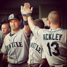 Mariners' Raul Ibanez oldest player to hit 20 home runs prior to the All-Star Break, being congratulated by Dustin Ackley  3 July 2013