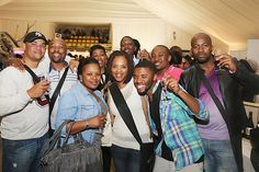 (L-R) Deon, Charles, Nqabisa, Puleng, Terry, Nkgomotso, Shane and Lonwabo celebrate at the 10th TOPS at SPAR Soweto Wine and Lifestyle Festival.
