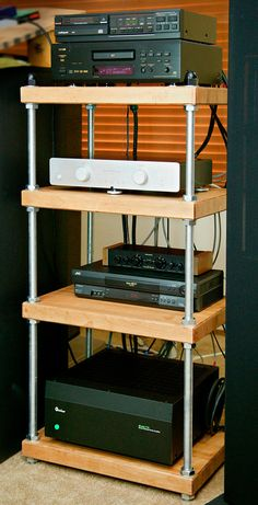 Maple Stereo Rack with All Thread Rods and  Natural Finish. I want to build this except modify it to hide wires.