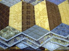 Zigzag to the Finish! Tips on binding zigzag quilt edges on the Quilters Newsletter blog.